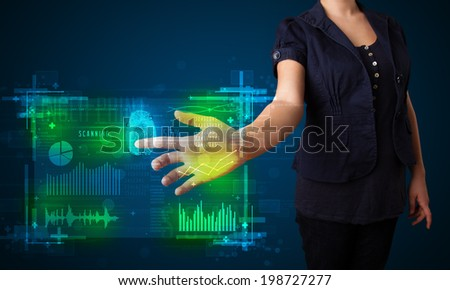 Businesswoman pressing modern technology panel with finger print reader  - stock photo
