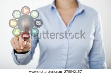 Businesswoman pressing web icons on the digital touch screen - stock photo