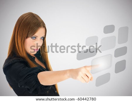 Businesswoman pushing button on screen interface. - stock photo