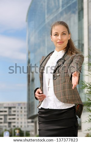Businesswoman ready to give handshake to partner - stock photo