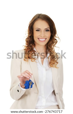 Businesswoman real estate agent giving keys.  - stock photo