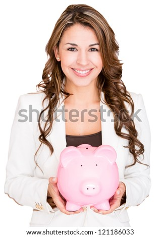 Businesswoman saving money in a piggybank - isolated over white - stock photo