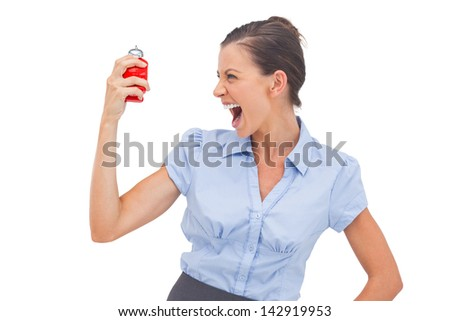 Businesswoman screaming at alarm clock on a white background - stock photo