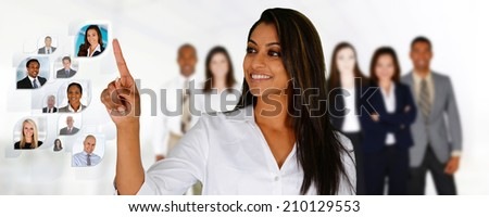Businesswoman selecting members of her business team - stock photo