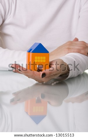 businesswoman selling a house (selective and soft focus) - stock photo