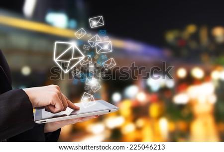 Businesswoman sending email  - stock photo