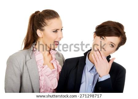 Businesswoman shouting on her yawning partner. - stock photo