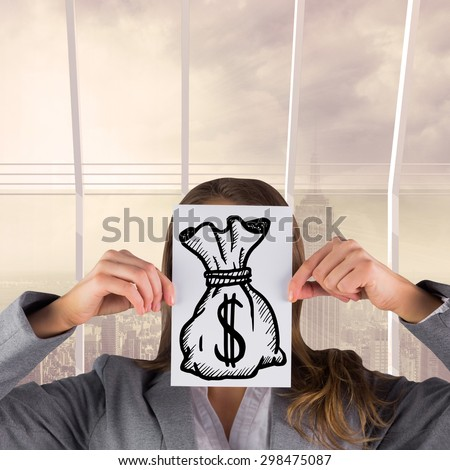 Businesswoman showing a card against room with large window looking on city - stock photo
