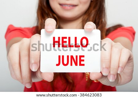 Businesswoman showing card with hello june message, - stock photo