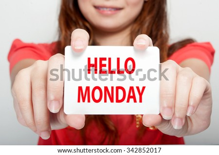 Businesswoman showing card with hello monday message, - stock photo
