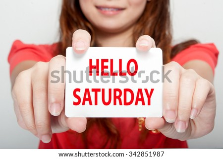 Businesswoman showing card with hello saturday message, - stock photo