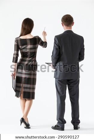 Businesswoman showing her business partner something, white background - stock photo