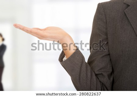 Businesswoman showing her empty hand. - stock photo