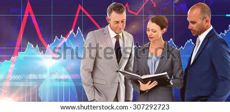 Businesswoman showing her notes to her colleagues against stocks and shares - stock photo