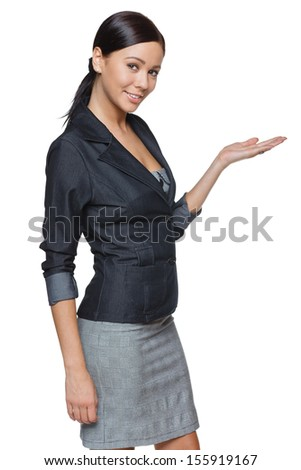 Businesswoman showing / holding on the palm blank copy space over white background - stock photo
