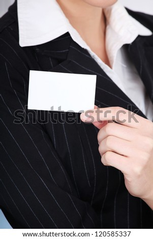 Businesswoman showing white blank business card. - stock photo