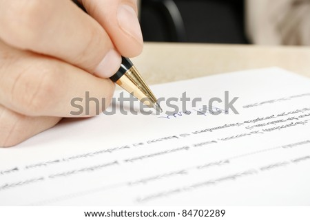 Businesswoman signing the contract - stock photo