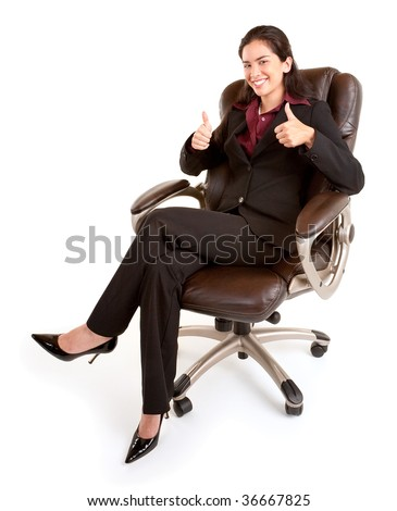 Businesswoman Sitting on a Leather Chair with Thumbs Up - stock photo