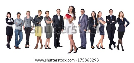 Businesswoman smile present gift red heart shaped box in hand. Woman over big group of Business people on background - stock photo