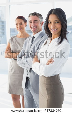 Businesswoman smiling while at work with co-workers - stock photo