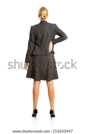 Businesswoman standing back in confident pose. - stock photo