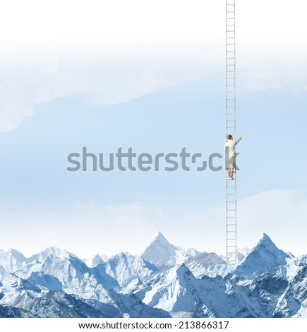 Businesswoman standing on ladder high above mountains - stock photo