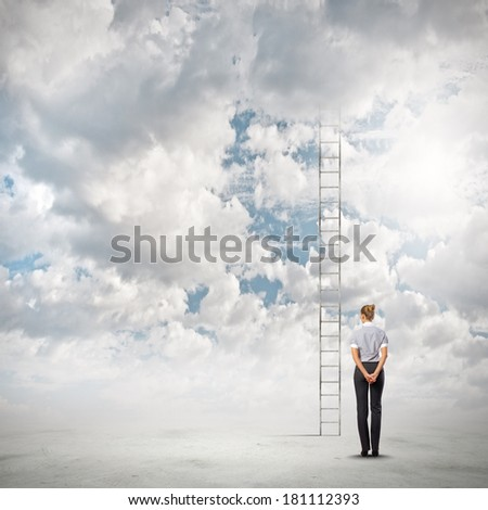 Businesswoman standing with back near long ladder to sky - stock photo