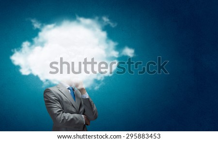Businesswoman standing with cloud instead of head - stock photo