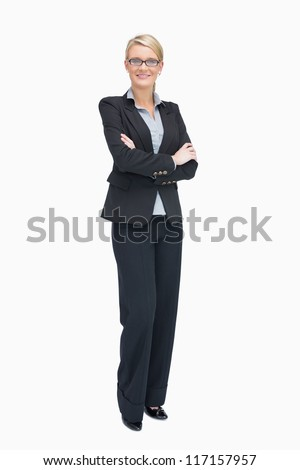 Businesswoman standing with folded arms while smiling - stock photo