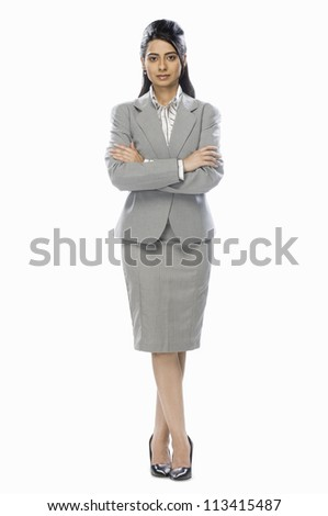 Businesswoman standing with her arms crossed - stock photo