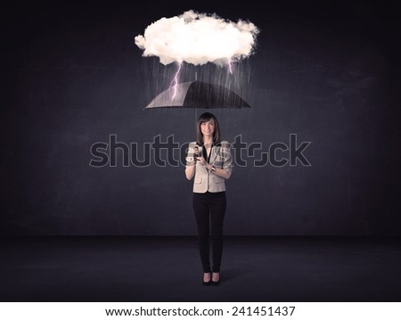 Businesswoman standing with umbrella and little storm cloud concept on background - stock photo