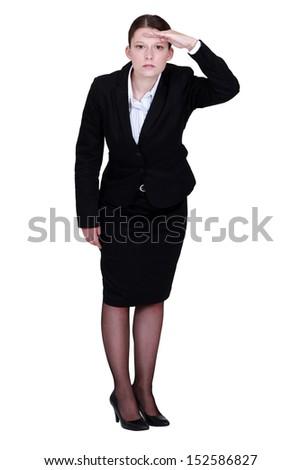 Businesswoman staring off into the horizon - stock photo