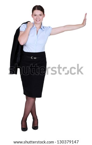 Businesswoman stood casually with her jacket over her shoulder - stock photo