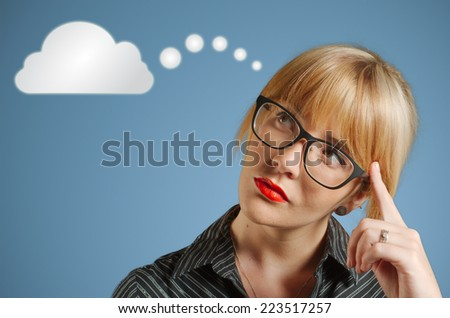 Businesswoman student or teacher with thought thinking cloud or computing - stock photo