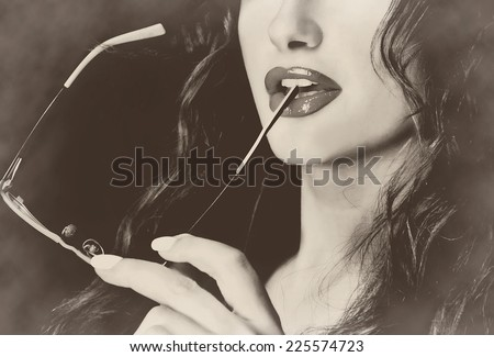 Businesswoman student teacher assistant holding glasses in her mouth seductive sexy - stock photo