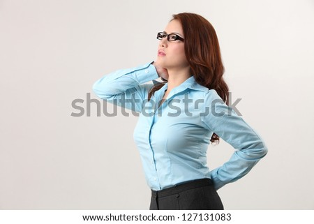 businesswoman suffering from backache and neck ache - stock photo