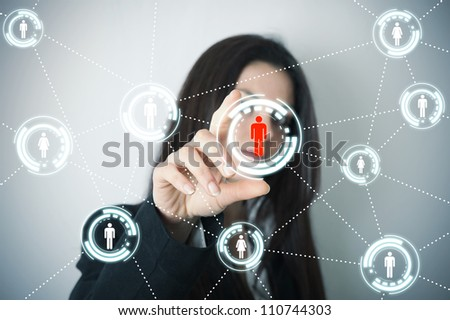 Businesswoman supports social network on futuristic screen - stock photo