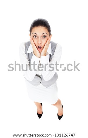 Businesswoman surprised scared, terrified hold hand, mouth open, young business woman concept of worried, shock, fear, full length portrait top angle view isolated on white background - stock photo