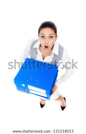 Businesswoman surprised scared, terrified hold stack folder, mouth open, young business woman concept of worried, shock lot of work, full length portrait top angle view isolated on white background - stock photo