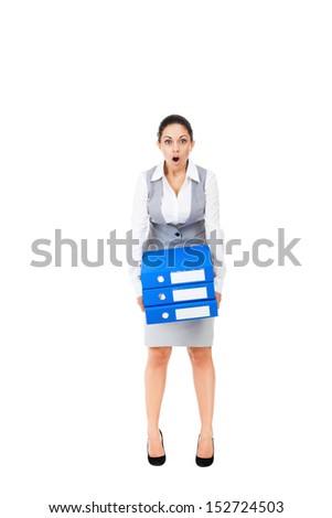 Businesswoman surprised scared, terrified hold stack folder, mouth open, young business woman concept of worried, shock lot of work, full length portrait isolated on white background - stock photo