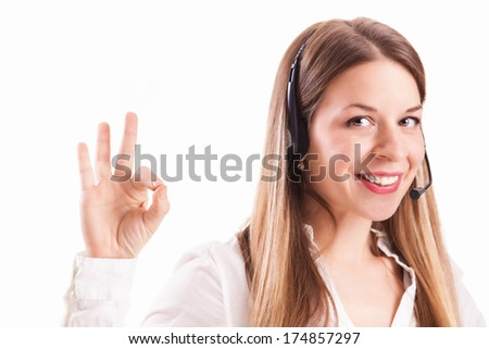 Businesswoman talking on headset with ok hand sign, isolated on white background.  - stock photo