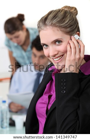 Businesswoman talking on her mobile phone - stock photo