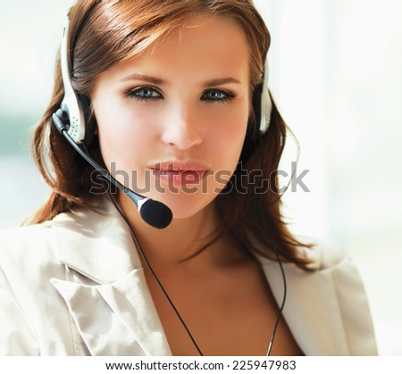 businesswoman talking on the phone while working on her computer at the office. - stock photo