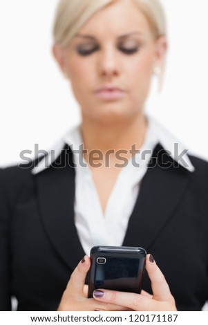 Businesswoman texting against white background - stock photo