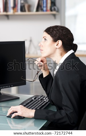 businesswoman thinking in her office - stock photo