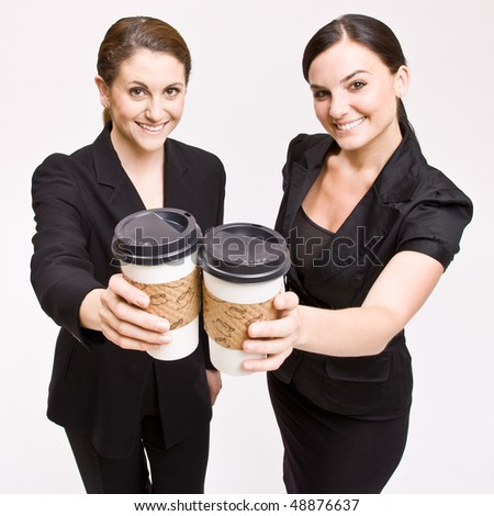 Businesswoman toasting with coffee cups - stock photo