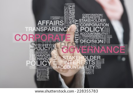 Businesswoman touch screen concept with Corporate Governance wordcloud - stock photo