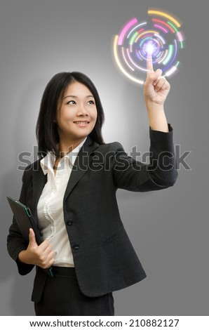 Businesswoman touch technology. - stock photo