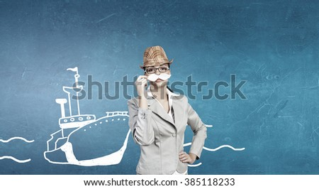 Businesswoman trying paper mustache - stock photo