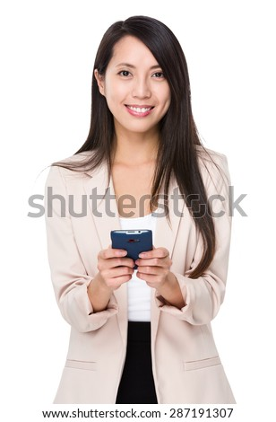 Businesswoman use of cellphone - stock photo